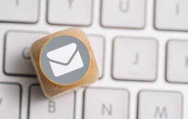 Email icon on a wood cube on a keyboard. Contact and Communication Methods concept image- Stock Photo or Stock Video of rcfotostock | RC-Photo-Stock