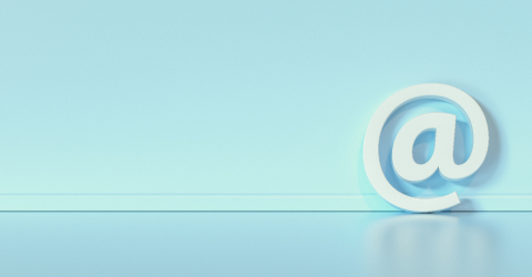 Email Icon or at sign leaning against a baby blue wall as a communication concept, copyspace for your individual text.- Stock Photo or Stock Video of rcfotostock | RC-Photo-Stock