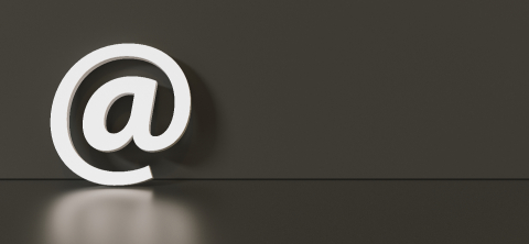 Email Icon or at sign leaning against a black wall as a communication concept, copyspace for your individual text. - Stock Photo or Stock Video of rcfotostock   RC-Photo-Stock
