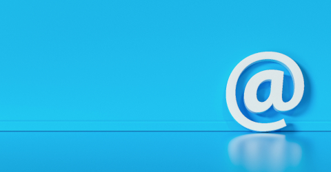 Email Icon or at sign leaning against a blue wall as a communication concept, copyspace for your individual text. - Stock Photo or Stock Video of rcfotostock | RC-Photo-Stock