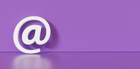 Email Icon or at sign leaning against a purple wall as a communication concept, copyspace for your individual text. - Stock Photo or Stock Video of rcfotostock | RC-Photo-Stock