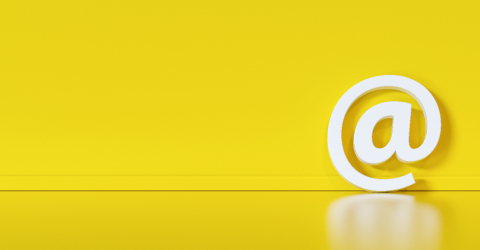 Email Icon or at sign leaning against a yellow wall as a communication concept- Stock Photo or Stock Video of rcfotostock | RC-Photo-Stock