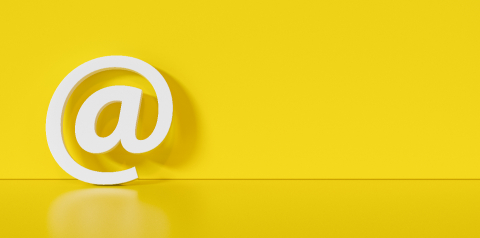Email Icon or at sign leaning against a yellow wall as a communication concept, copyspace for your individual text. - Stock Photo or Stock Video of rcfotostock | RC-Photo-Stock