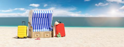 Empty beach chair with suitcases flip-flop sandals, sunglasses on the beach of the Baltic Sea or North Sea in Germany as a summer vacation concept image, copy space for individual text- Stock Photo or Stock Video of rcfotostock | RC-Photo-Stock