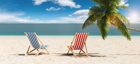 Empty beach chairs next to a palm tree at the beach during a summer vacation in the Caribbean- Stock Photo or Stock Video of rcfotostock | RC-Photo-Stock