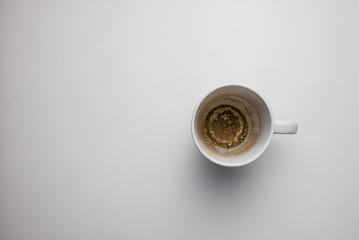 Empty coffee cup after drink on a white table, with copy space for individual text - Stock Photo or Stock Video of rcfotostock   RC-Photo-Stock
