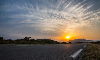Empty long road on a sunny summer day at bright sunset- Stock Photo or Stock Video of rcfotostock | RC-Photo-Stock