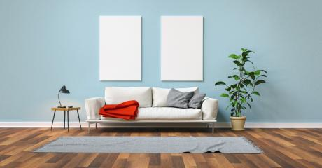 Empty white canvas on blue wall with sofa in the living room- Stock Photo or Stock Video of rcfotostock | RC-Photo-Stock