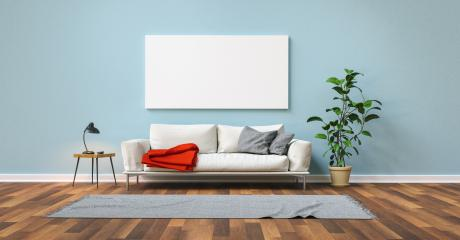 Empty white panorama canvas on blue wall with sofa in the living room- Stock Photo or Stock Video of rcfotostock | RC-Photo-Stock