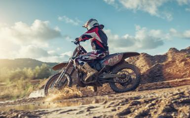 Enduro Extreme Motocross MX rider in Action on a dirt track- Stock Photo or Stock Video of rcfotostock | RC-Photo-Stock