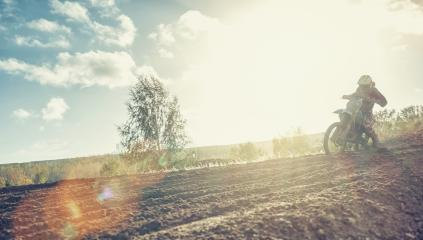 Enduro racer on dirt track on his Motocross MX cycle at sunset- Stock Photo or Stock Video of rcfotostock | RC-Photo-Stock
