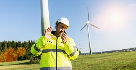 Engineer working a wind turbines, talking on the walkie-talkie for controlling work- Stock Photo or Stock Video of rcfotostock | RC-Photo-Stock
