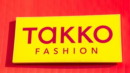 ESCHWEILER, GERMANY FEBRUARY, 2017: TAKKO fashion Logo.. TAKKO is one of the largest German textile traders with over 1,900 branches in Germany and other European countries.- Stock Photo or Stock Video of rcfotostock | RC-Photo-Stock
