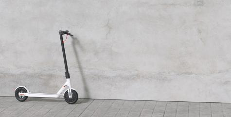 e-scooter parked on a sidewalk at a wall for urban mobility. copyspace for your individual text.- Stock Photo or Stock Video of rcfotostock | RC-Photo-Stock