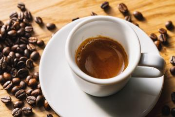 espresso cup with roasted beans on wooden table background- Stock Photo or Stock Video of rcfotostock | RC-Photo-Stock