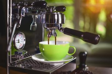 Espresso out of classic coffee machine into coffee cup- Stock Photo or Stock Video of rcfotostock | RC-Photo-Stock