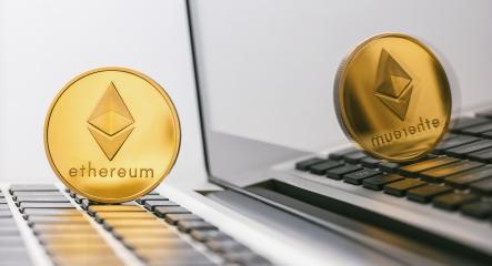 ethereum coin - Digital cryptocurrency on notebook- Stock Photo or Stock Video of rcfotostock | RC-Photo-Stock