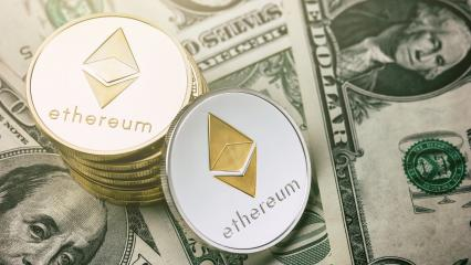 Ethereum crypto-currency on dollar notes- Stock Photo or Stock Video of rcfotostock | RC-Photo-Stock