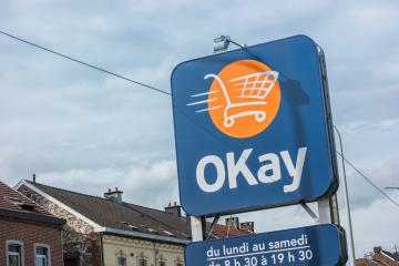 EUPEN, GERMANY OCTOBER, 2017: OKay supermarket logo sign. OKay is a neighbourhood stores supermarket chain of the Colruyt Group.- Stock Photo or Stock Video of rcfotostock | RC-Photo-Stock