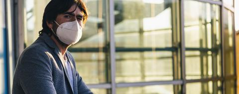 European man in clothes on the street with a medical face mask on. Closeup of a 40-year-old male in a respirator to protect against infection with influenza virus or coronavirus covid 19- Stock Photo or Stock Video of rcfotostock | RC-Photo-Stock