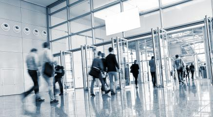 European Tradeshow Visitors walking in a modern hall- Stock Photo or Stock Video of rcfotostock | RC-Photo-Stock