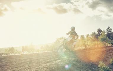 Extreme Motocross MX racer accelerating in dirt track at bright sunset- Stock Photo or Stock Video of rcfotostock   RC-Photo-Stock