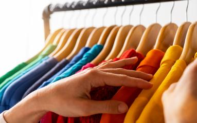Fashion clothes hanging on clothing rack - bright colorful rainbow selection of clothes closet. Woman choose outfits on hangers in store closet. LGBT colors- Stock Photo or Stock Video of rcfotostock | RC-Photo-Stock