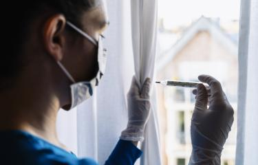 fearful and  infection woman in corona quarantine looking out of window to a  clinical thermometer - stay at home- Stock Photo or Stock Video of rcfotostock | RC-Photo-Stock