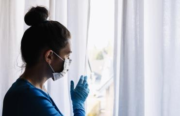 fearful woman in corona quarantine looking out of window to the street - Stock Photo or Stock Video of rcfotostock | RC-Photo-Stock