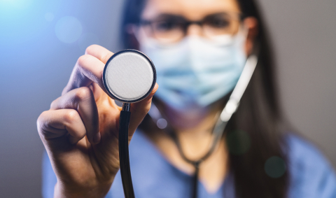 female doctor in protective mask holding stethoscope and looking at camera. Concept medicine image, level of medicine, virus, epidemic corona or covid-19- Stock Photo or Stock Video of rcfotostock | RC-Photo-Stock
