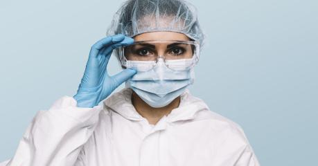 Female Doctor or Nurse Wearing latex protective gloves and medical Protective Mask and glasses on face. Protection for Coronavirus COVID-19- Stock Photo or Stock Video of rcfotostock | RC-Photo-Stock