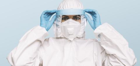 Female Doctor or Nurse Wearing latex protective gloves and medical Protective Mask with shield and glasses on face. Protection for Coronavirus COVID-19.- Stock Photo or Stock Video of rcfotostock | RC-Photo-Stock