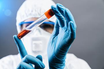 Female doctor or Scientist holds Invented red vaccine against covid 19 or Coronavirus- Stock Photo or Stock Video of rcfotostock | RC-Photo-Stock