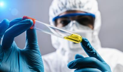 Female doctor or Scientist holds Invented yellow vaccine against covid 19 or Coronavirus- Stock Photo or Stock Video of rcfotostock | RC-Photo-Stock