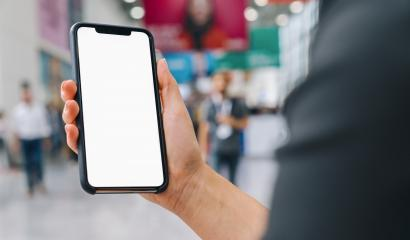 Female hand holding black cellphone with white screen at a trade fair, copyspace for your individual text.- Stock Photo or Stock Video of rcfotostock | RC-Photo-Stock