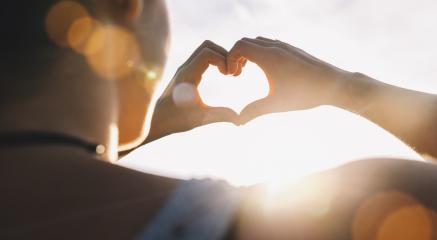 Female hands in the form of heart against the sky pass sun beams. Hands in shape of love heart- Stock Photo or Stock Video of rcfotostock | RC-Photo-Stock