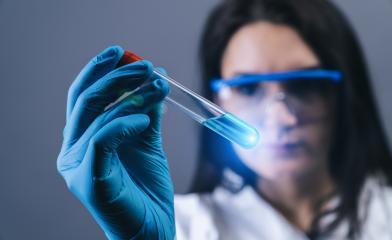 female medical lab worker holding 2019-nCoV Coronavirus Test tube. Positive Blood Sample in Scientist Hand. Coronavirus outbreaking- Stock Photo or Stock Video of rcfotostock | RC-Photo-Stock