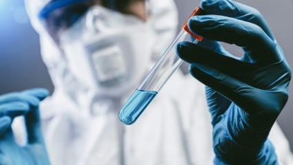 female medical or scientific researcher or woman doctor looking at 2019-nCoV Coronavirus Test tube. Positive Blood Sample. Coronavirus outbreaking- Stock Photo or Stock Video of rcfotostock | RC-Photo-Stock