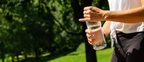 Female runner holding bottle of water. Drinking water concept. copyspace for your individual text. banner size- Stock Photo or Stock Video of rcfotostock | RC-Photo-Stock