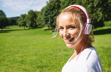 Female Runner Jogging during Outdoor Workout in a Park with headphones. copyspace for your individual text.- Stock Photo or Stock Video of rcfotostock | RC-Photo-Stock