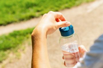 Female runner open bottle of water. healthy lifestyle fitness sport concept image- Stock Photo or Stock Video of rcfotostock   RC-Photo-Stock