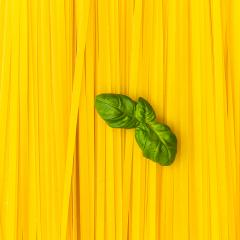 Fettuccine noodles with basil leaf background- Stock Photo or Stock Video of rcfotostock | RC-Photo-Stock