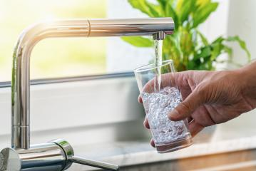 Filling glass of water from stainless steel kitchen faucet : Stock Photo or Stock Video Download rcfotostock photos, images and assets rcfotostock | RC-Photo-Stock.: