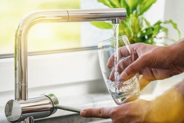Filling glass of water from stainless steel kitchen faucet- Stock Photo or Stock Video of rcfotostock | RC-Photo-Stock