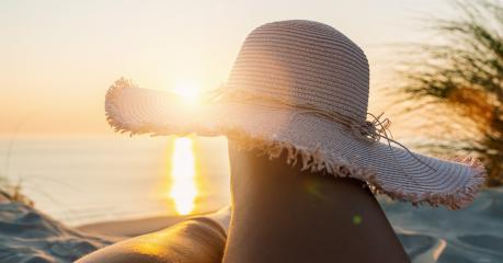 First person perspective of woman legs with straw hat on sunset beach- Stock Photo or Stock Video of rcfotostock | RC-Photo-Stock