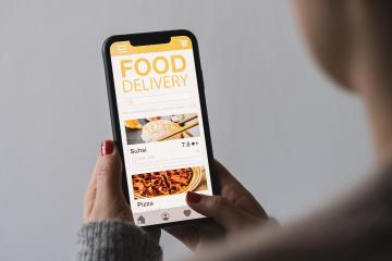 Food delivery app on a mobile phone. Restaurant order online. Woman using smartphone to get take away lunch home delivered. Fast courier service. Suhsi and Pizza menu mock up in cellphone screen. : Stock Photo or Stock Video Download rcfotostock photos, images and assets rcfotostock | RC-Photo-Stock.: