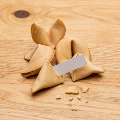 fortune cookies with a note on wooden table- Stock Photo or Stock Video of rcfotostock | RC-Photo-Stock