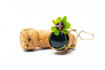 Four-leaf clover on champagne corks- Stock Photo or Stock Video of rcfotostock | RC-Photo-Stock