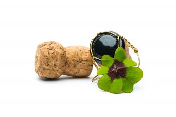 Four-leaf clover on corks- Stock Photo or Stock Video of rcfotostock | RC-Photo-Stock