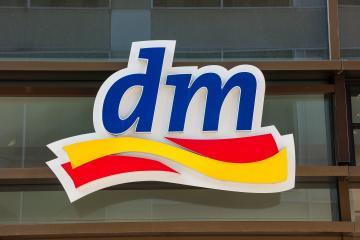 FRANKFURT, GERMANY MARCH, 2017: Dm drogeriemarkt logo. Headquartered in Karlsruhe, Dm-drogerie markt is a chain of retail drugstore chain for cosmetics, healthcare and household products and food.- Stock Photo or Stock Video of rcfotostock | RC-Photo-Stock